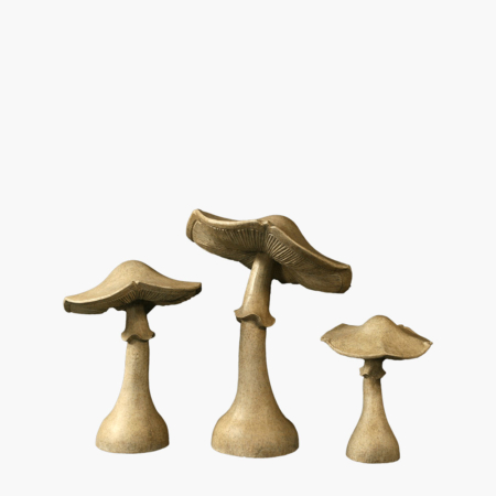 Large mushroom sculptures made from concrete.